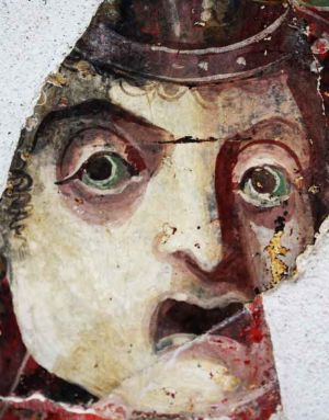 Roman fresco fragment depicting a face1