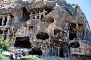 Ruins of ancient rock cut tombs in Tlos Turkey